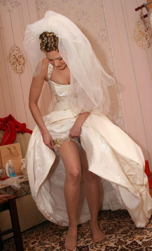 Blonde Young Bride wearing White Sheer Pantyhose and White Satin Dress: www.tootop.com/pix/galleries/brides/white_sheer_pantyhose/Blonde...