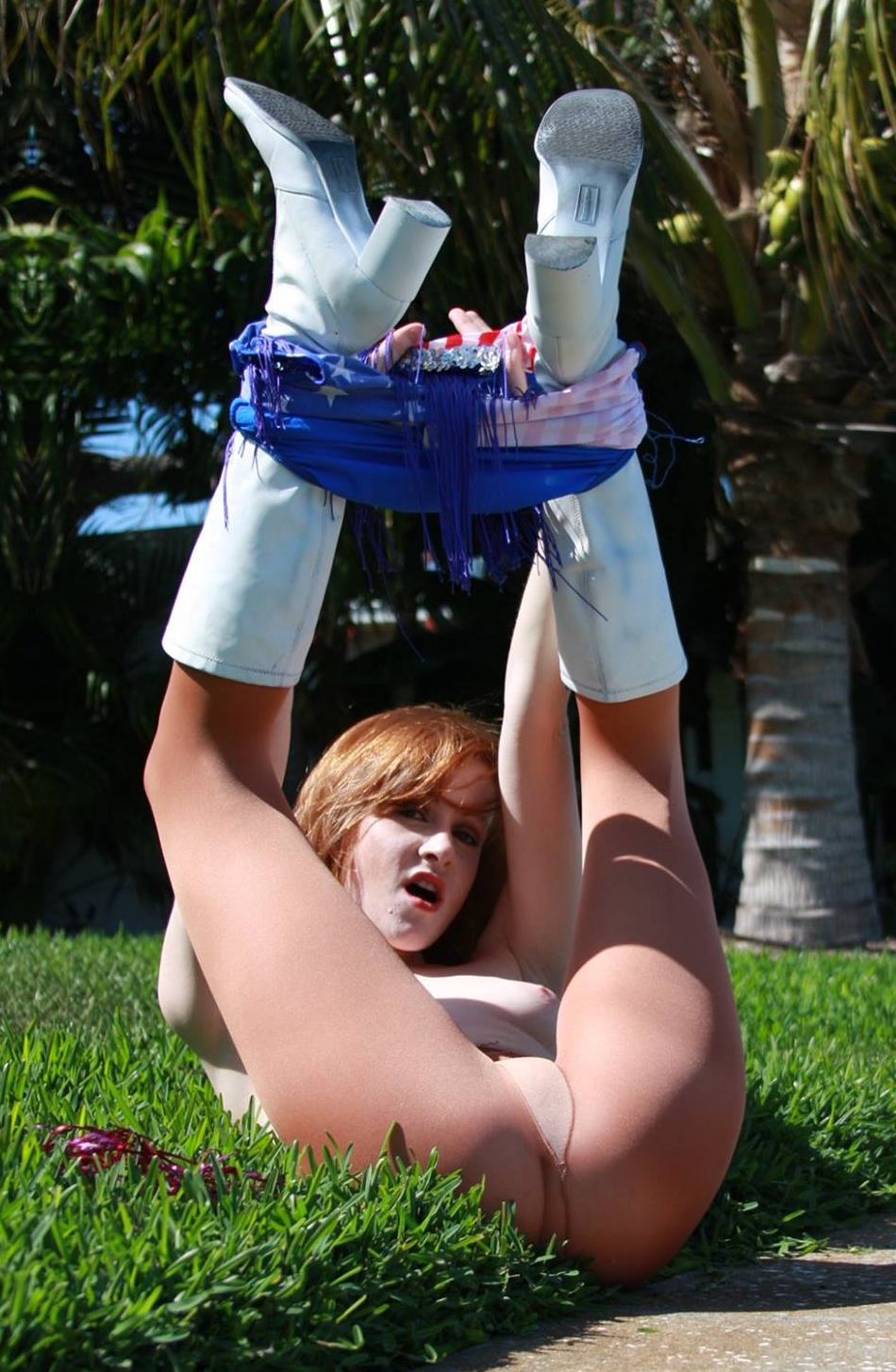 Redhead Cheerleader wearing Tan Sheer Pantyhose and Showing Boobs