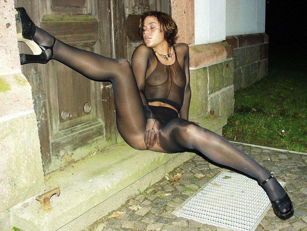 Auburn Girl encased in Black Sheer Pantyhose wearing Black High Heels