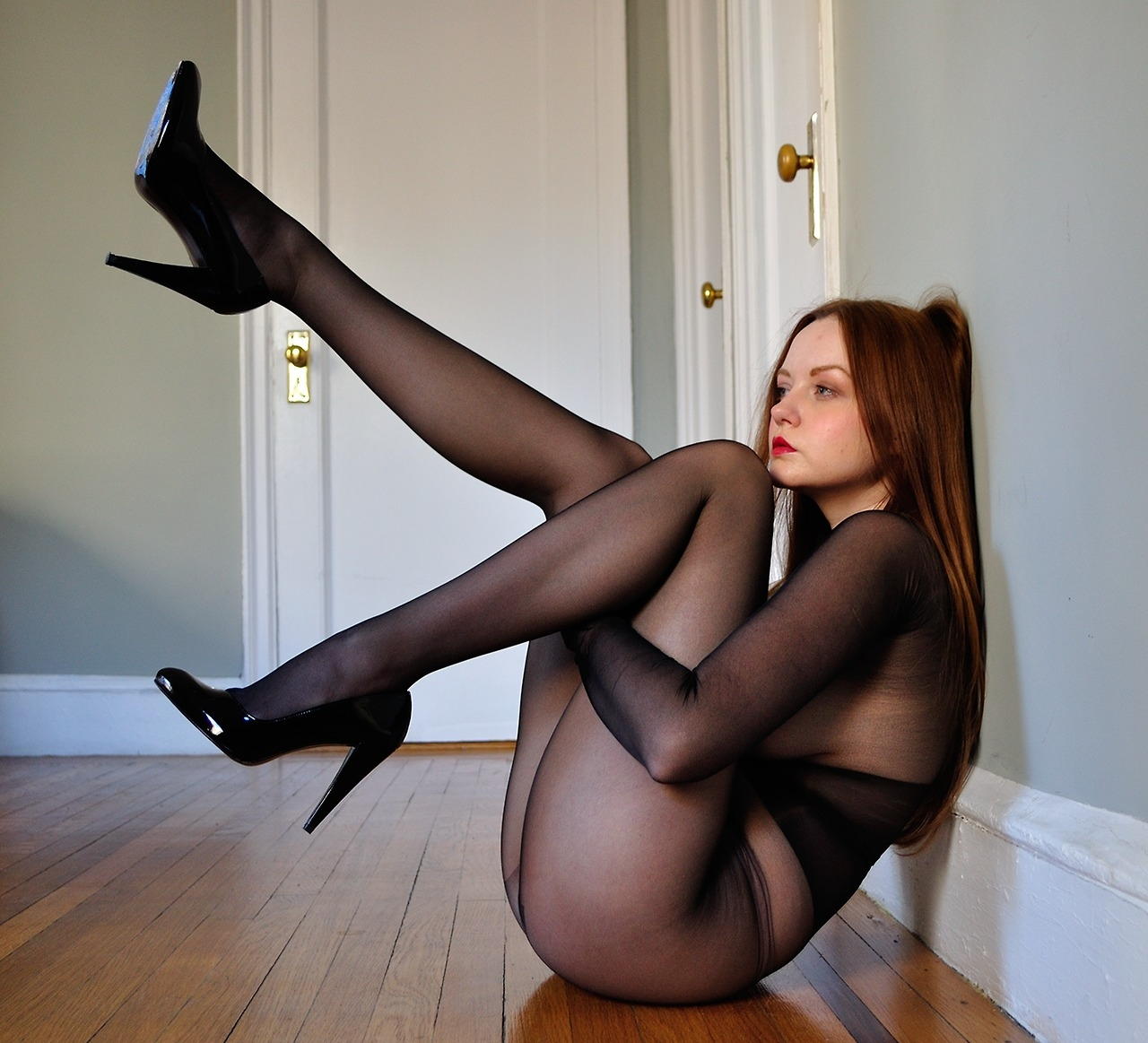 Redhead Girl encased in Black Sheer Pantyhose wearing Black Stilettos