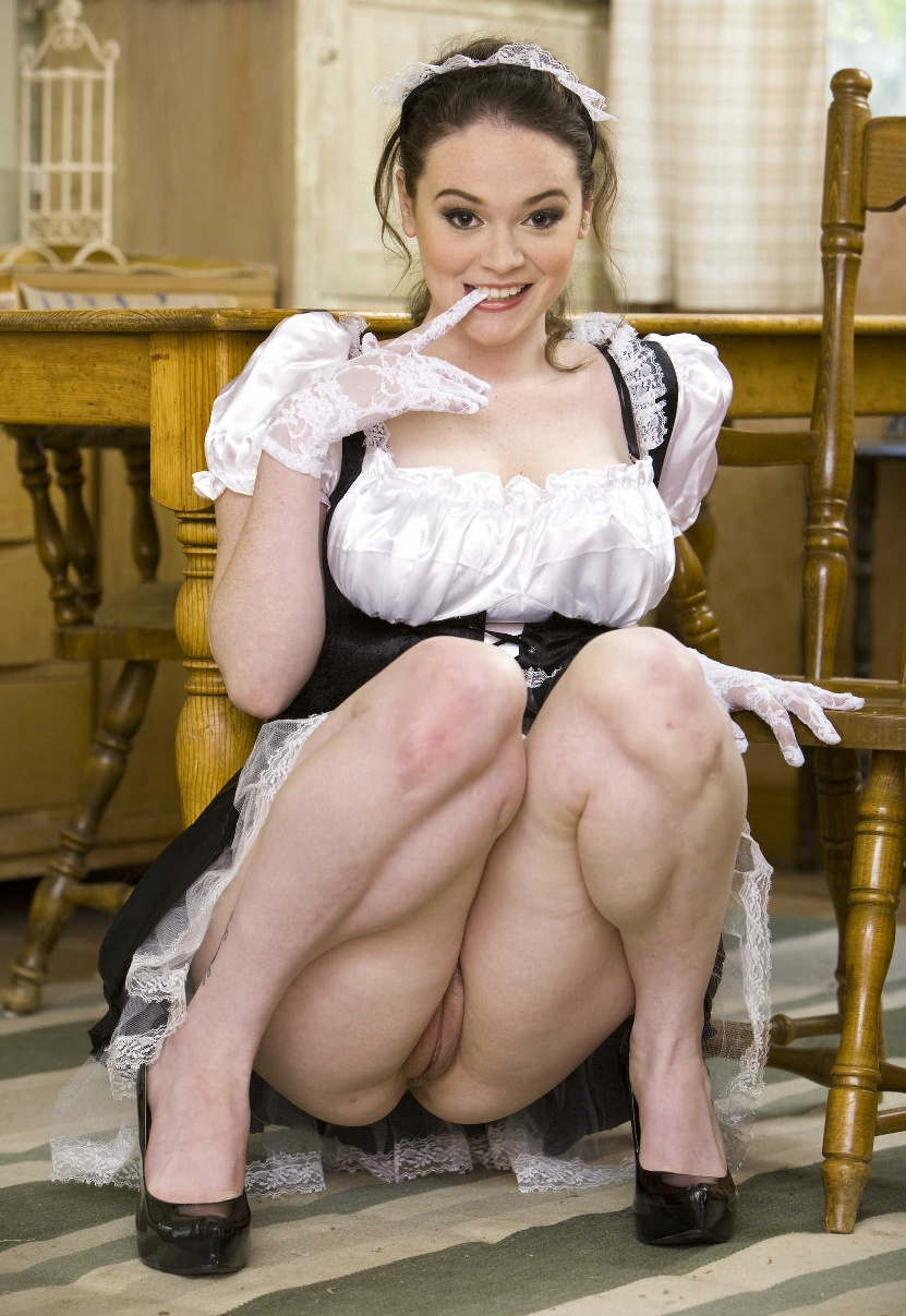 brunette french maid with bare legs wearing black high heels and