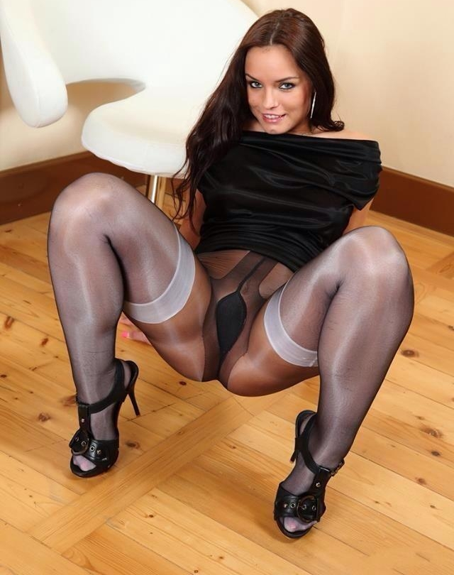 Big black wearing shiny pantyhose
