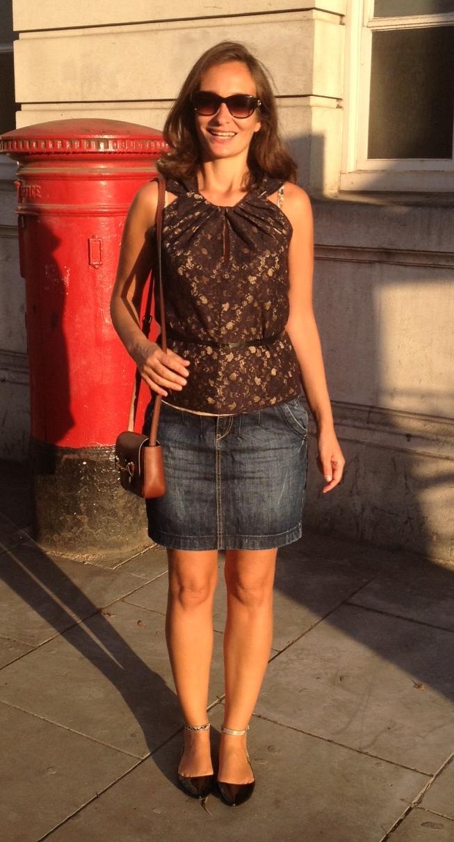 milf wearing blue denim mini skirt with bare legs