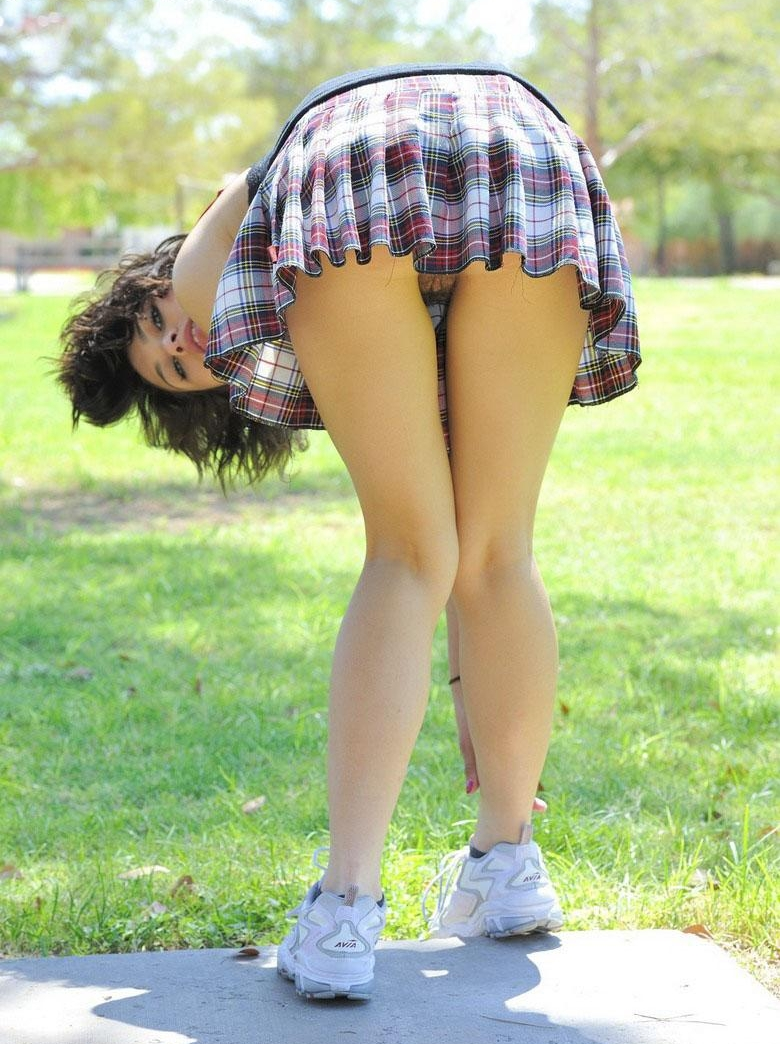 Brunette Schoolgirl with Bare Legs Upskirt showing Pussy